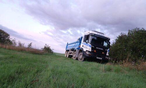 C.E.S.L. Tipper Lorry in Field